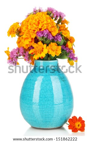 Bouquet of marigold flowers in vase isolated on white - stock photo