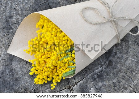 Bouquet of mimosa flowers on wooden background - stock photo
