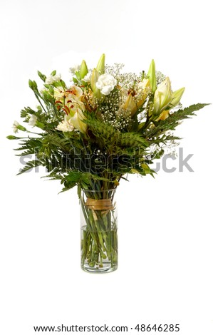 Bouquet of mixed flowers in vase taken on a white background