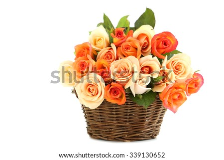 Bouquet of orange roses in basket isolated on white - stock photo