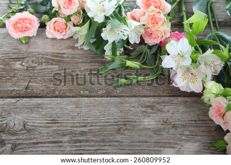 Bouquet of pink and white flowers on a wooden background