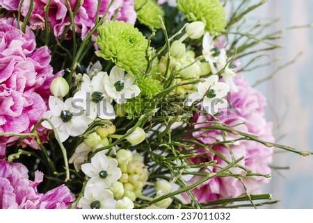 Bouquet of pink carnation, arabian star flower (ornithogalum arabicum) and green chrysanthemums - stock photo