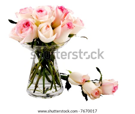 Bouquet of pink roses in glass vase isolated on white - stock photo
