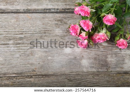 Bouquet of pink roses on a wooden background