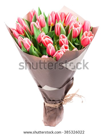 bouquet of pink tulips in a package of kraft paper, isolated on white background, shallow DOF - stock photo