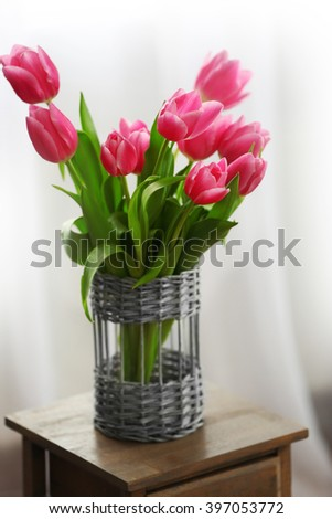 Bouquet of pink tulips in a vase, close up