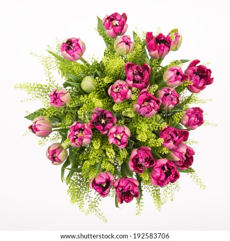 bouquet of pink tulips with green leaves top view