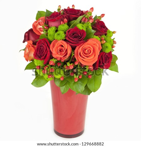 bouquet of red and orange roses in vase isolated on white background - stock photo