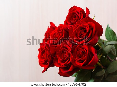 Bouquet of red roses on a light background.