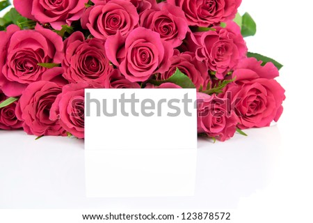 Bouquet of roses and a greeting card isolated on white background - stock photo