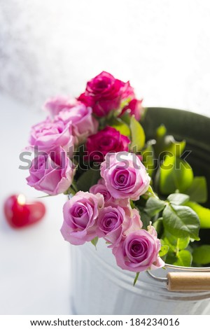 Bouquet of roses in a bucket.