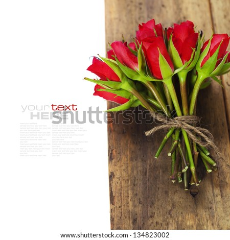 Bouquet of roses on wooden board (with easy removable text) - stock photo