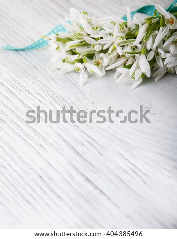 bouquet of snowdrops on a old wooden table - stock photo