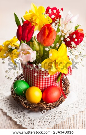Bouquet of spring flowers and easter eggs for Easter - stock photo
