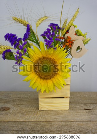 Bouquet of sunflowers, daisies, cornflowers, ears of wheat and leaves isolated on a white background