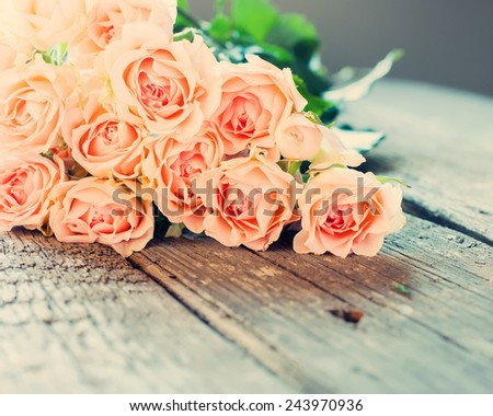 Bouquet of Tender Roses on Wooden Table, toned instagram effect - stock photo