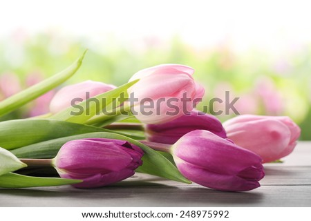 Bouquet of tulips on table,Closeup. - stock photo