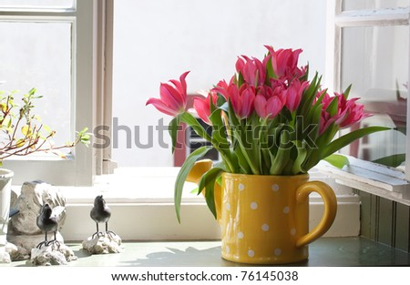 bouquet of tulips on the windowsill - stock photo