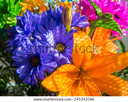 Bouquet of various vividly colorful flowers on a display - stock photo