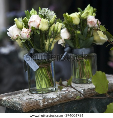 bouquet of white and pink rose in vase of glass. - stock photo
