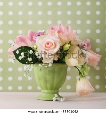 Bouquet of white and pink roses in the green vase - stock photo