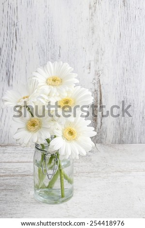 Bouquet of white gerbera flowers on wooden background - stock photo