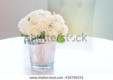 Bouquet of white rose in glass vase near the window.(soft tone)