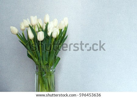 bouquet of white tulips in a glass vase