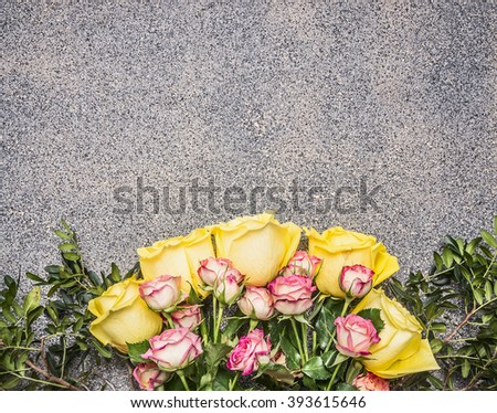 bouquet of yellow and pink spring shrub roses border ,place for text on wooden rustic background top view close up - stock photo