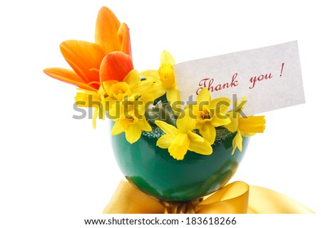 bouquet of yellow daffodils with tulips in green vase - stock photo