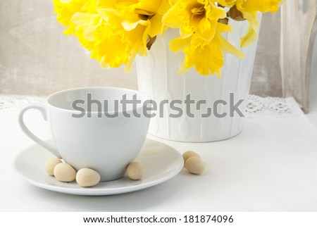 Bouquet of yellow narcissus on the table - stock photo