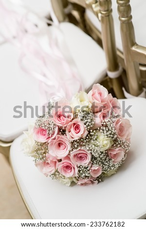 bouquet on white chair,Bouquet of white wedding chairs - stock photo