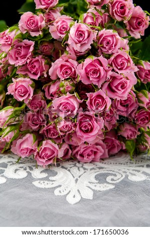 bouquet roses lying on silk  - stock photo