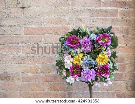 Bouquet,square composition of colorful flowers on the brick wall background, natural light, horizontal photo - stock photo