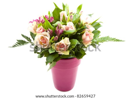 Bouquet with different kind of colorful flowers in a pink vase - stock photo