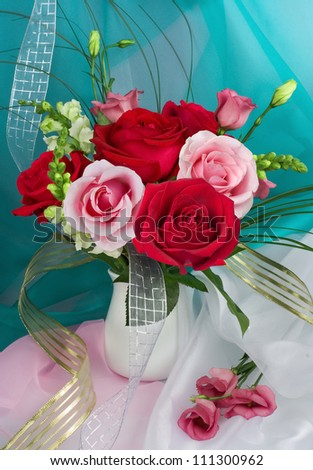 Bouquet with pink and red roses in a glass vase - stock photo