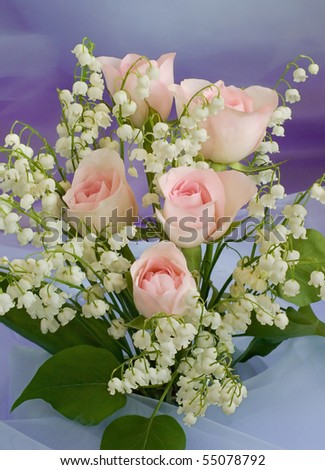 Bouquet with roses and lilies of the valley - stock photo