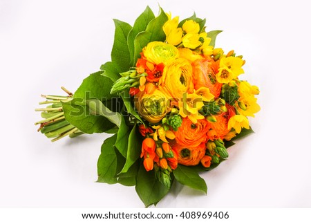 Bouquet yellow ranunkulyus with green leaves on bright background  - stock photo