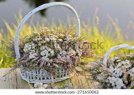 Bouquets of flowers in baskets - stock photo