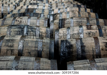 Bourbon barrels on their side in a distillery - stock photo