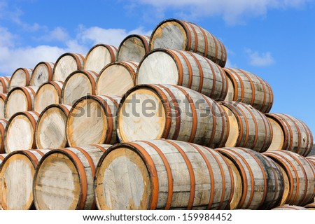 Bourbon barrels stacked at a distillery in Scotland - stock photo
