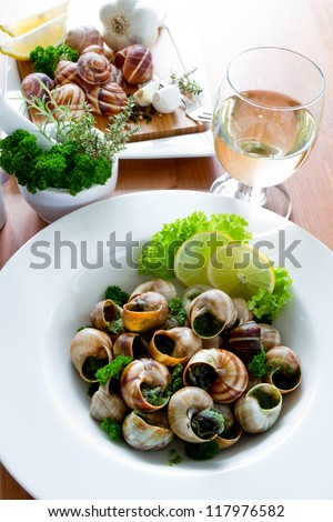 Bourguignonne snail au gratin. Escargots de Bourgogne (snails with herbs butter) - stock photo