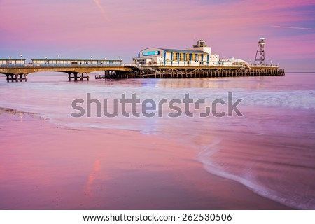 Bournemouth pier at Sunset from the beach Dorset England UK Europe