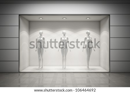 Boutique display window with mannequins - stock photo