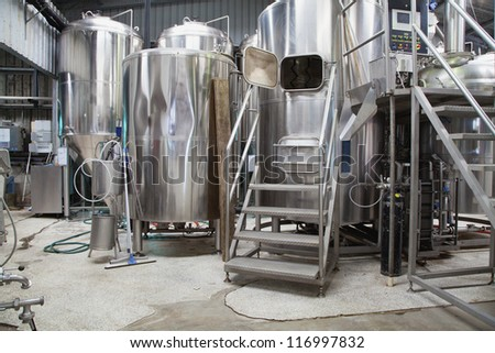 Boutique micro brewery with stainless steel equipment - stock photo