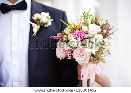 boutonniere and bouquet (soft focus, focus on the flowers of bouquet)
