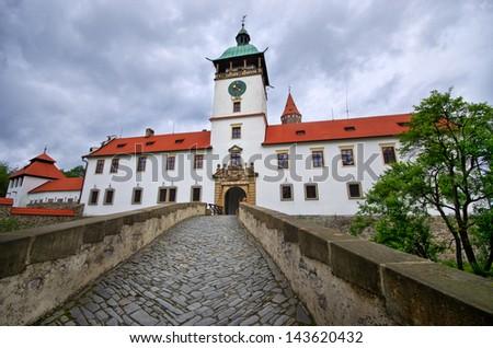 Bouzov castle with dramatic sky in Czech Republic - stock photo
