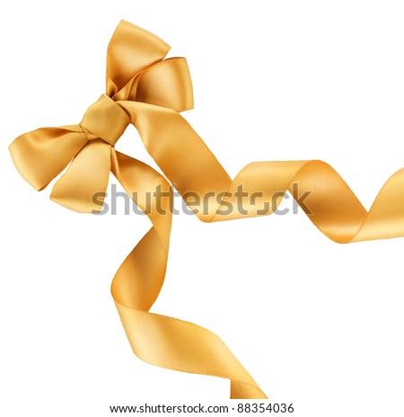 Bow. Golden satin gift bow. Ribbon. Isolated on white - stock photo