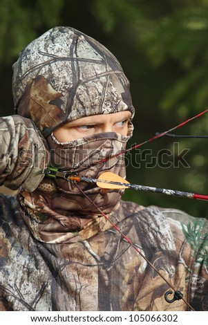 bow hunter in camouflage closup - stock photo