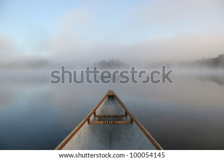 Bow of a Canoe on a Misty Lake in Ontario, Canada